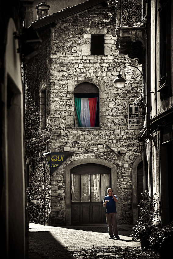 Italian Man Drinking Espresso on the Narrow Streets of Como, Italy