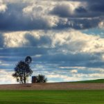 Lone Windmill on the Amish Horizon - Farm Land in Lancaster, PA